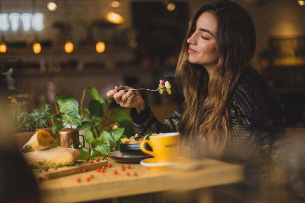 A person eating a meal in a nice cafe