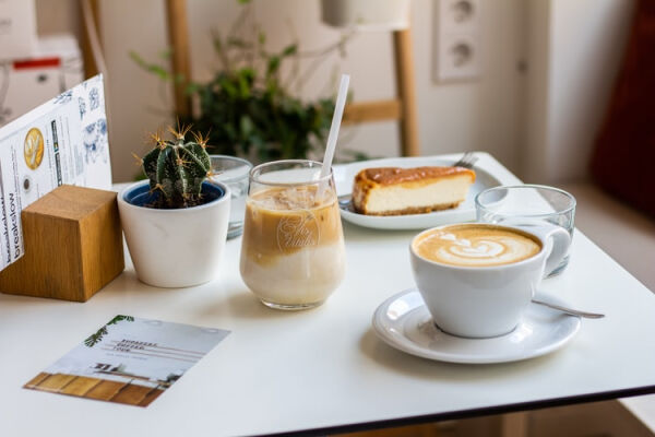 A picture of coffee and cake on a table