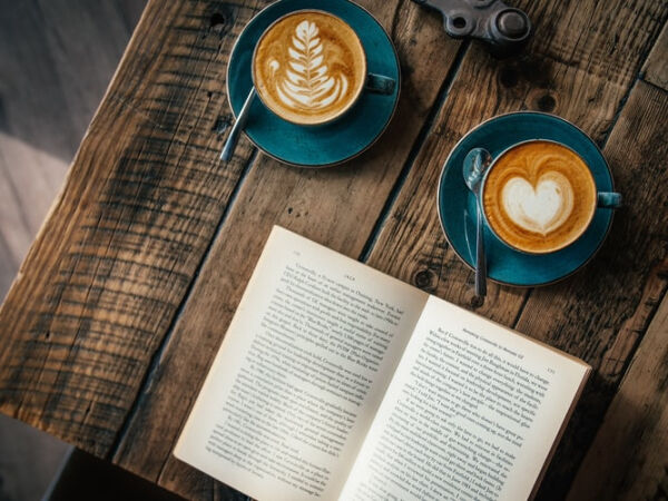 A book and a cup of coffee on a table