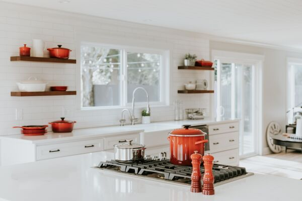 A kitchen hob and side stocked with high quality pans and accessories