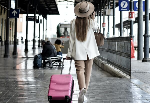 A picture of a woman walking on a platform